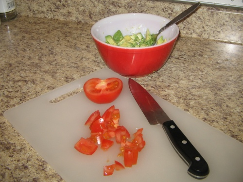 Next, 1/2 a tomato, chopped